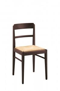 Moderna stolica od drva sa sjedištem od slame. Može se naručiti i u drugim bojama drva i sa drugim sjedištem.