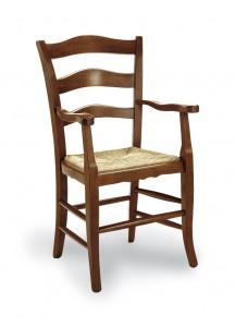 Klasična stolica sa rukonaslonima, izrađena od masivnog drva u boji oraha sa sjedištem od slame. Dimenzije 100 x 60 x 60 cm. Može se naručiti u različitim bojama drva, te sjedištima od slame, tkanine ili drva.
