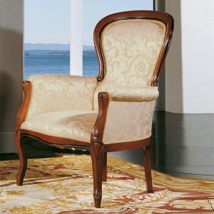 Klasična fotelja sa okvirom od masivnog drva u boji trešnje. Presvlaka u tekstilu bež bije sa zlatnim uzorkom. Može se naručiti u drugim materijalima i bojama.