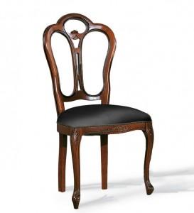 Klasična drvena stolica u boji oraha, sjedište i leđa u eko koži. Može se nručiti u raznim drugim bojama drva i različitim materijalima za sjedište.