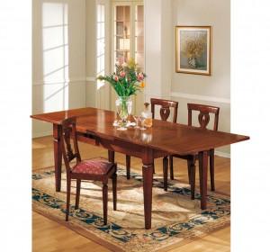 Klasična blagavaona izrađena od masivnog drva u boji oraha sa drvenim stolom na razvlačenje te drvenim stolicama u kompletu. Stolice se mogu naručiti u raznim vrstama tkanina. Može se naručiti i u drugim bojama drva.