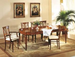 Klasična blagavaona izrađena od masivnog drva u boji oraha sa drvenim ovalim stolom na razvlačenje te drvenim stolicama u kompletu. Stolice se mogu naručiti sa ili bez rikonaslona, te u raznim vrstama tkanine. Može se naručiti i u drugim bojama drva.