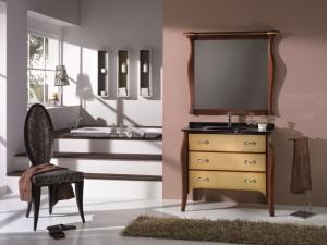 Klasični stilski element za lavabo sa 3 ladice, u kompletu sa klasičnim ogledalom. Bojano u klasičnu boju oraha, sa frontama ladica u zlatno. Može se naručiti i u drugim bojama.